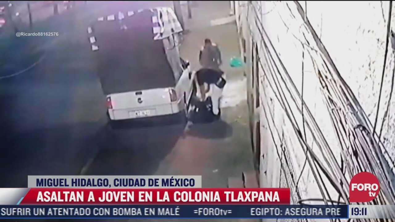 video asaltantes someten por la espalda a joven en la miguel hidalgo