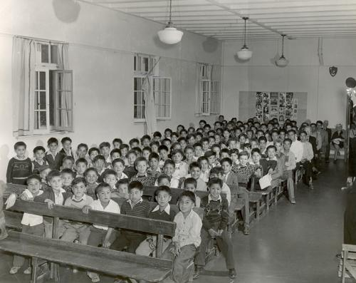 Indigenous Pupils sit in a classroom in an Indian Residential School