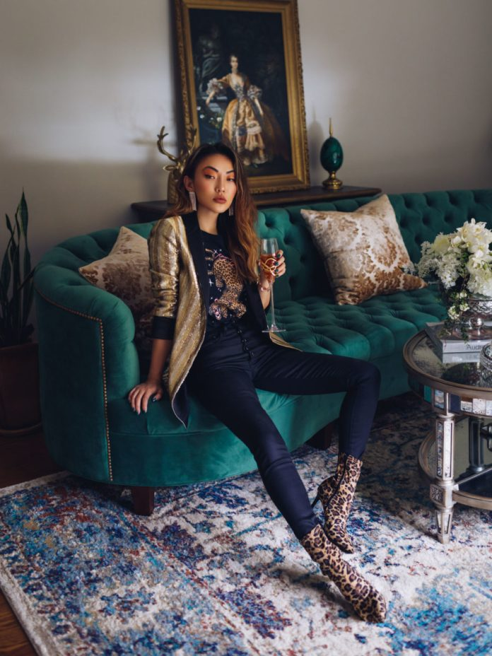 Jessica Wang wearing a glitter blazer with a leopard graphic tee, skinny jeans, and leopard print booties // Jessica Wang - Notjessfashion.com