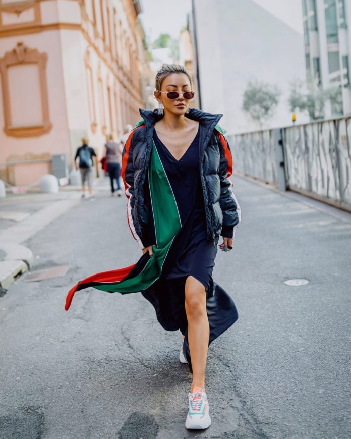 Jessica Wang wearing a puffer coat with a silk v neck dress and sneakers while sharing her favorite fall and winter coats // Jessica Wang - Notjessfashion.com