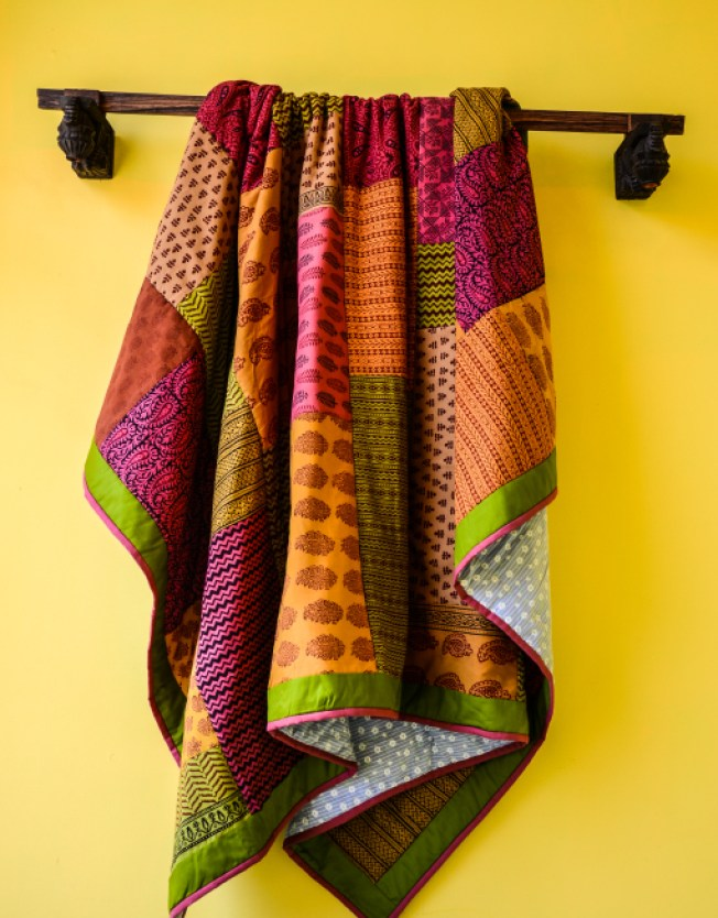 Summer quilt in gorgeous, bright colours via