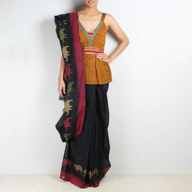 Kasuti traditonal motif on a plain black saree ... love it ! via