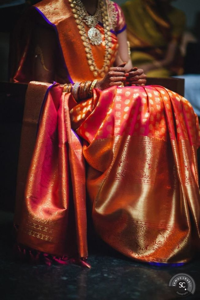A bridal kanjeevaram - stunning red with a hint of blue; absolutely stunning via