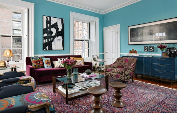 Bohemian decor with traditional elements like the Suzani throw and contrasting wall art via