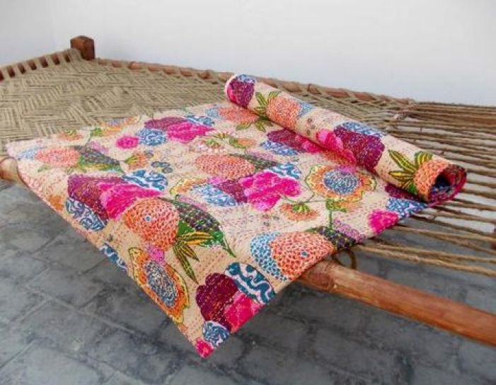 Kantha throw...gorgeous anywhere and would look spectacular on your 'charpai' ... via