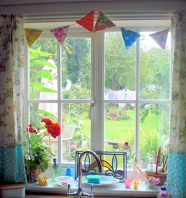 The buntings, the hand made curtains...an absolute essential, I'd say...via