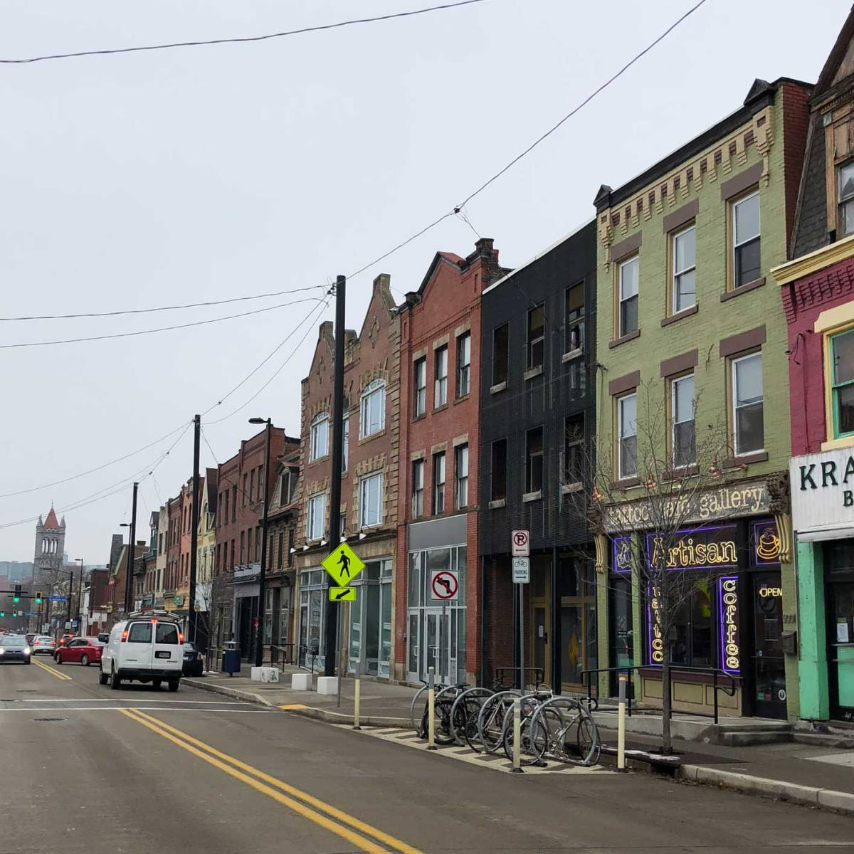 An image of a grey sky and quaint buildings on Penn Ave. in Pittsurgh