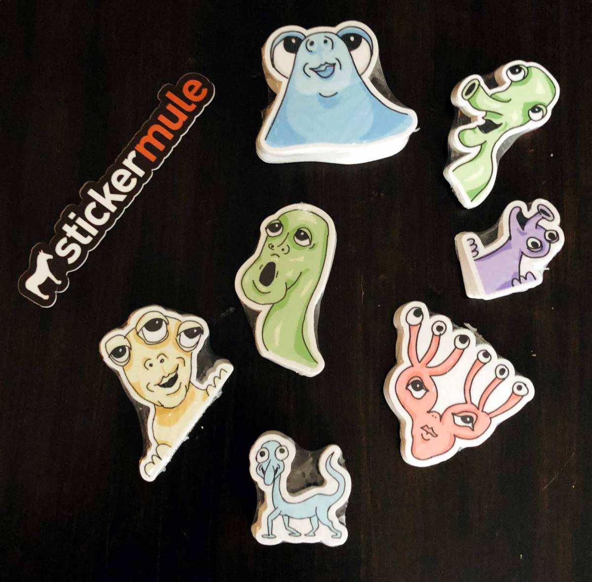 Several multicolored stickers of very cute and friendly monsters.
