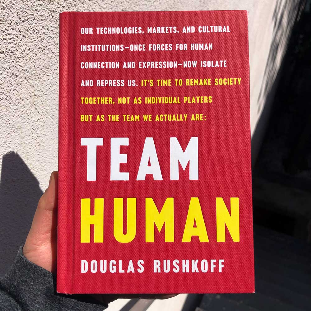 "Cover of the book, Team Human with the text ""Our technolgies, markets, and cultural institutions – once forces for human connection and expression – now isolate and repress us. It's time to remake society together, not as individual players but as the team we actually are"""