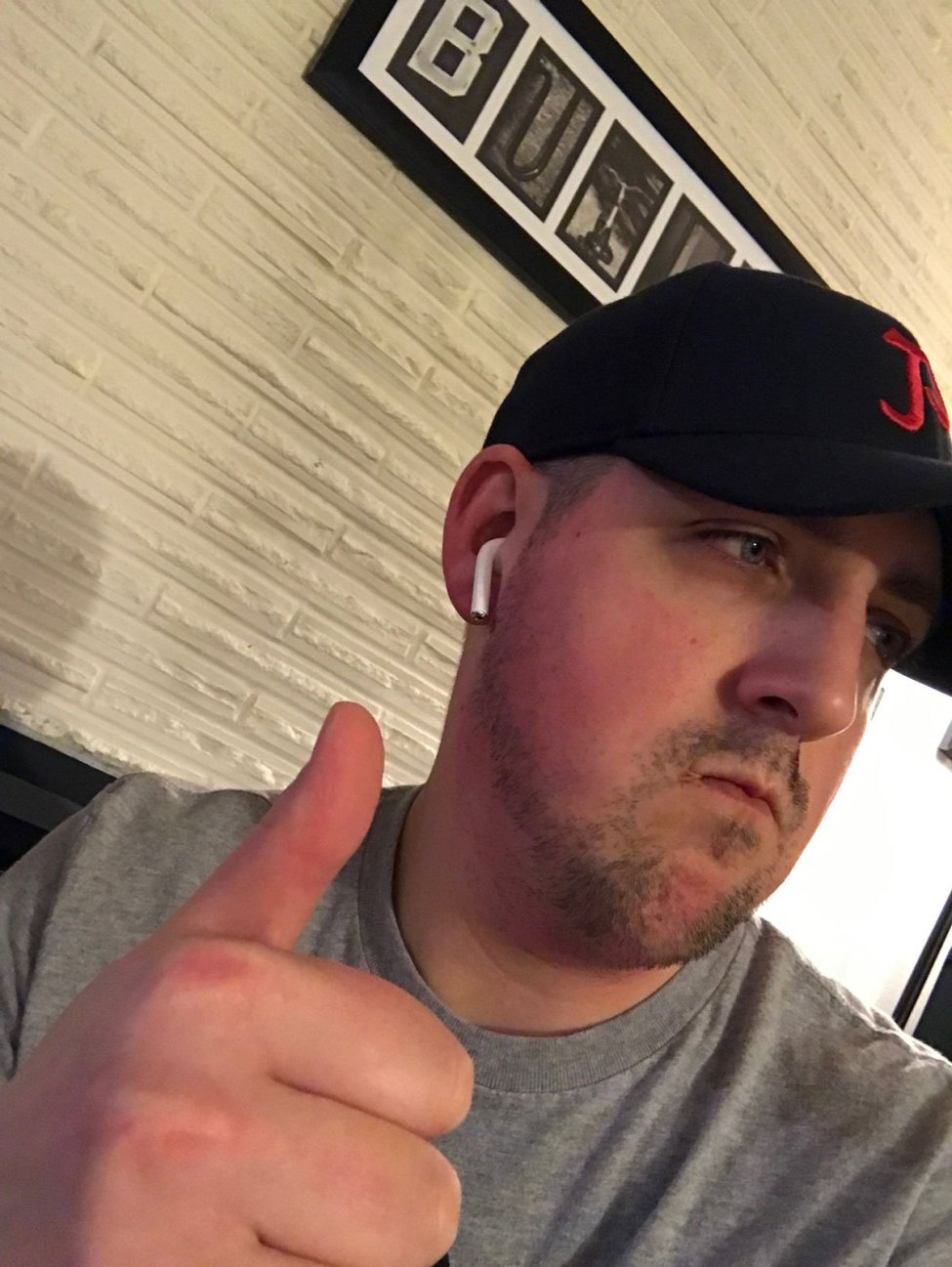 Jared gives AirPods a thumbs up.
