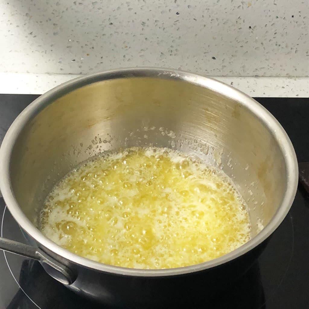 Butter boiling in a saucepan.