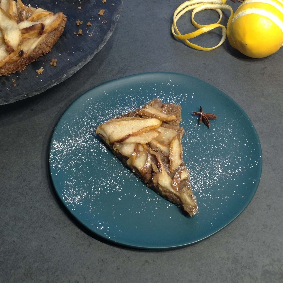 Slice of Pear Tart with Brown Butter Crust on a blue plate