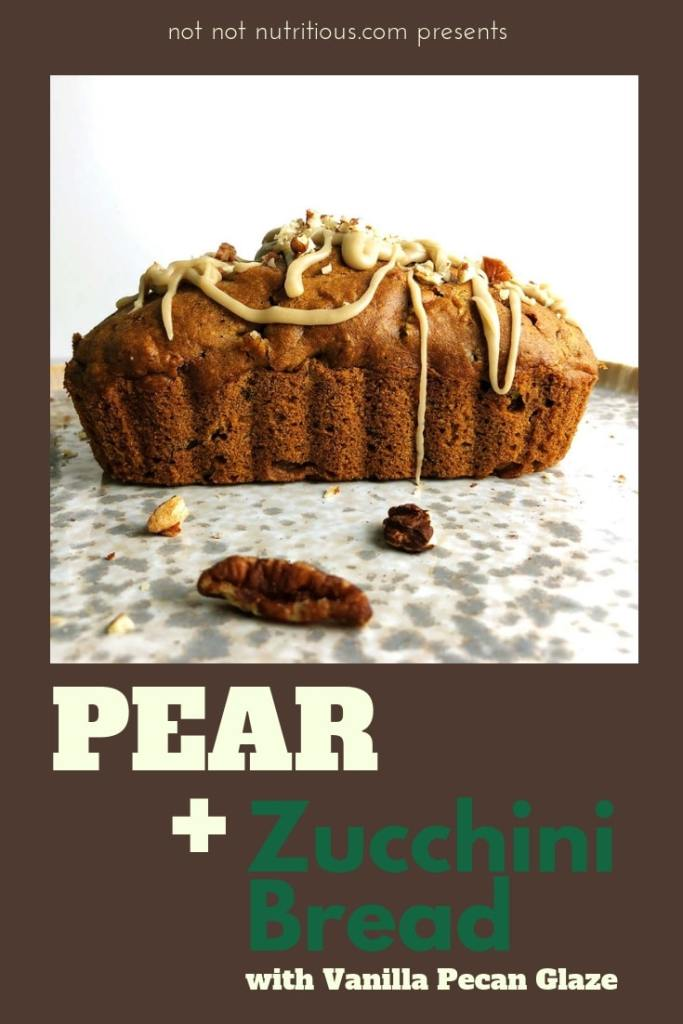 Pear and Zucchini Bread with Vanilla Pecan Drizzle on mottled gray plate.