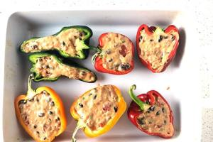Green, red, and yellow peppers, cut from stem to tip, and stuffed with rice, beans, tomatoes, and chipotle cheese sauce mix.