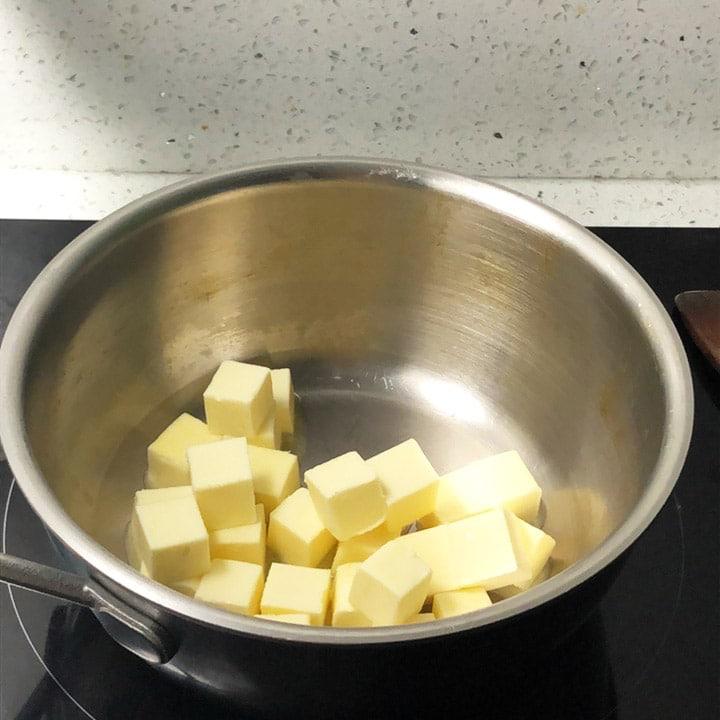 Cubes of butter in a saucepan.