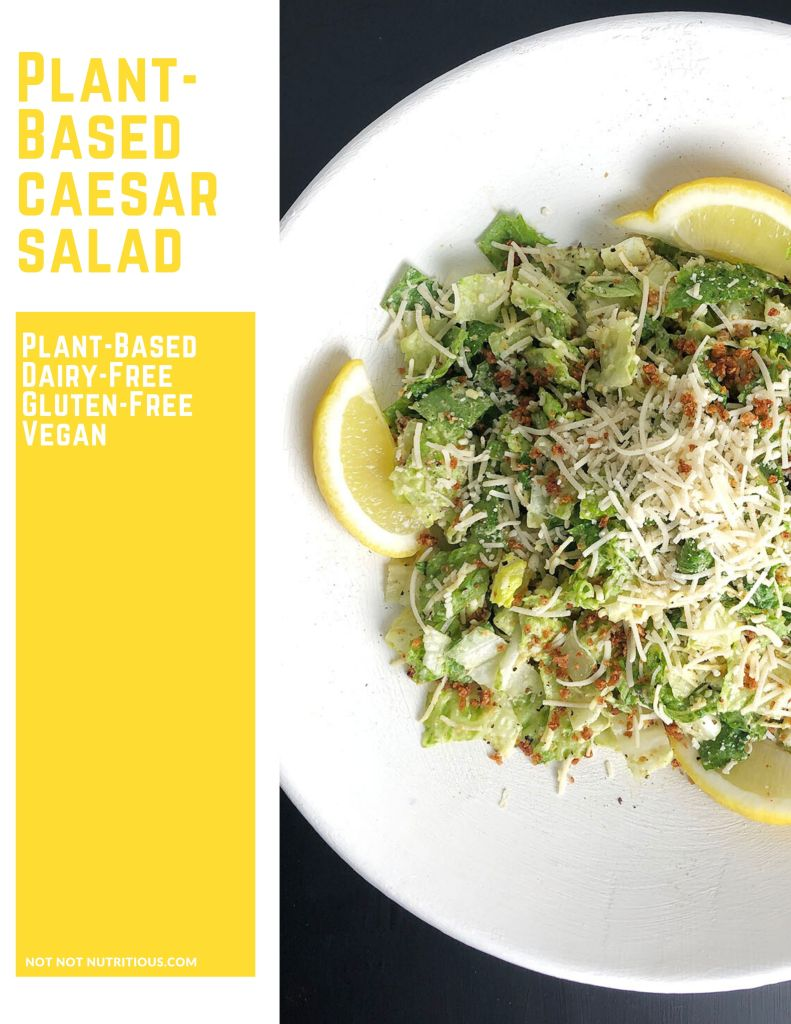Graphic with text in yellow lettering: Plant-Based Caesar Salad. Dairy-free, gluten-free, vegan, alongside a top-down close up shot of Caesar Salad in a black bowl with lemon slices.