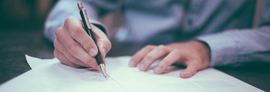 Man writing or signing something