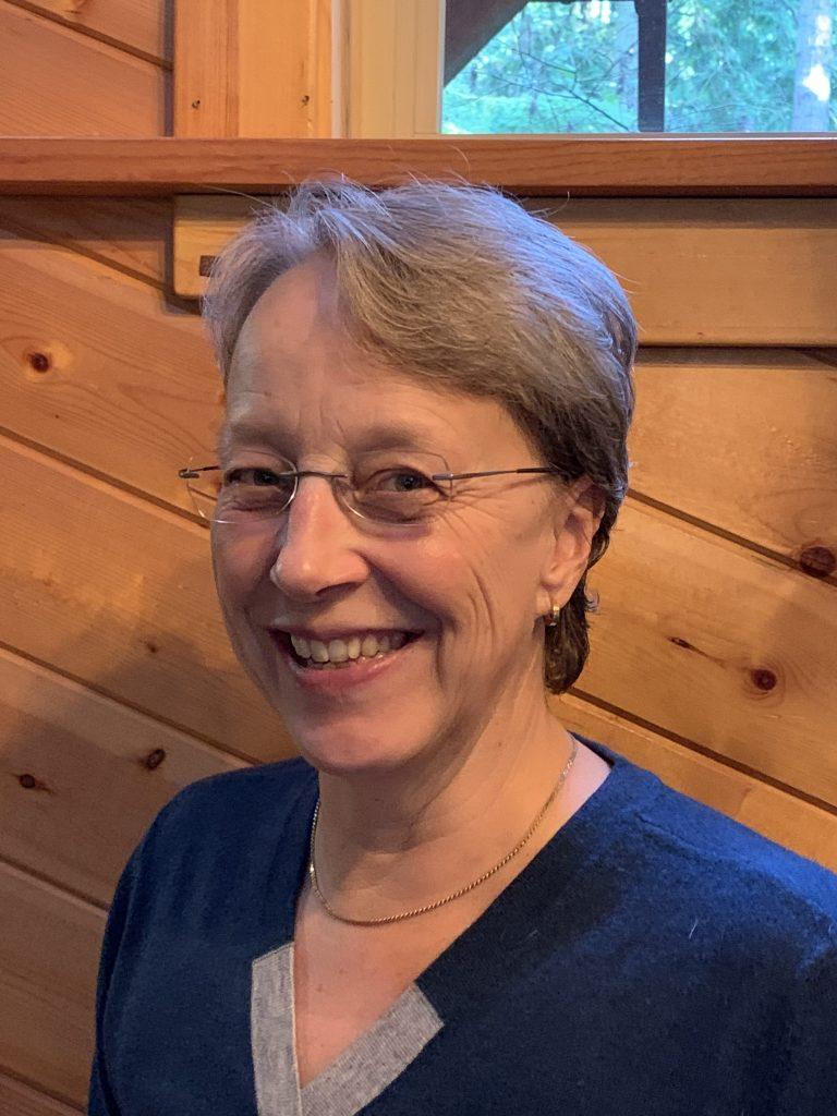 Full color portrait headshot flat advocacy nonprofit Not Putting on a Shirt NPOAS Advisory Council member Dr. Corine De Boer