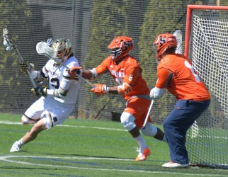 Captain Jack Near strikes to end a double overtime thriller against undefeated Syracuse.
