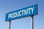 A sign with the word productivity written on it emphasizing that Standing Desks help a person become more productive.