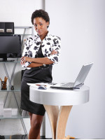 woman standing at laptop desk