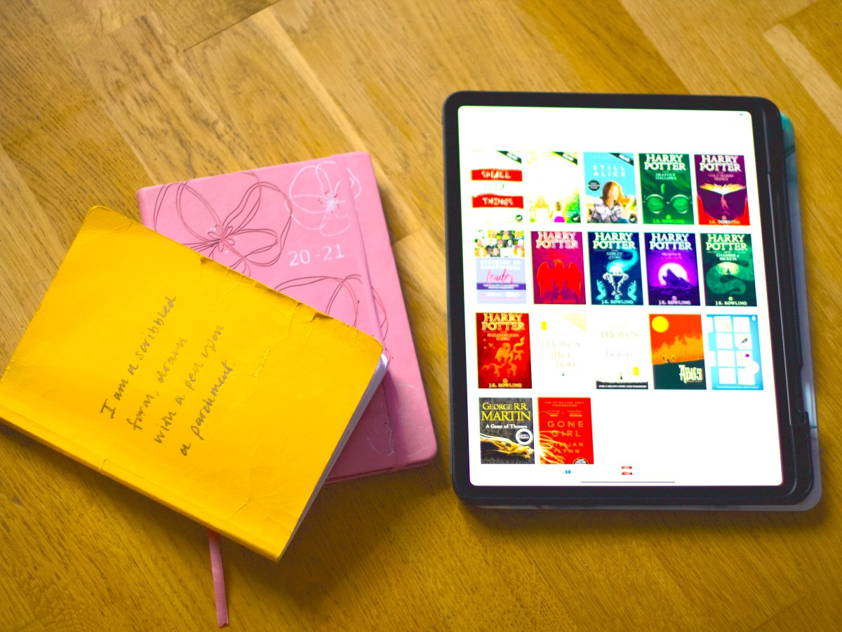 """My iPad with all my books on it next to my diary and note book- that says 'I am a scribbled form, dreams with pen upon a parchment"""" King Arthur."""