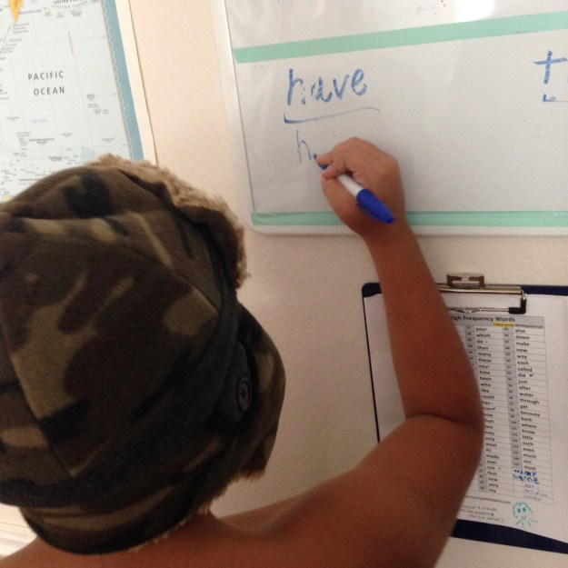 Practicing sight words, shirtless and in a winter hat when it's 90 degrees outside is all the rage.