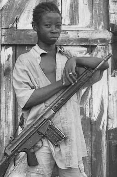 An African child soldier wearing a H&K G3 rifle