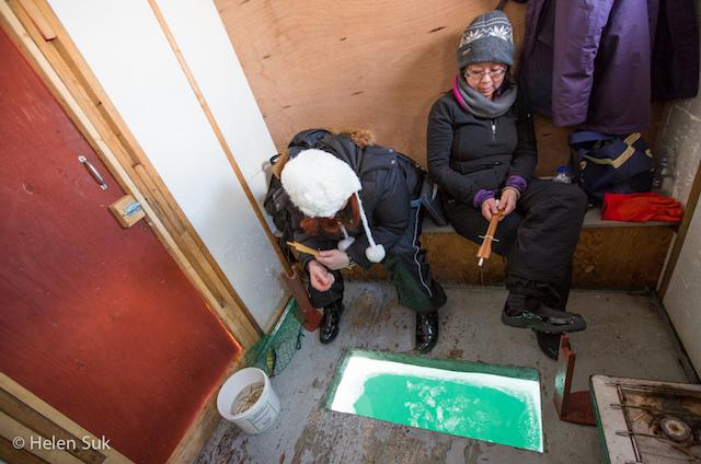 women in ice fishing hut