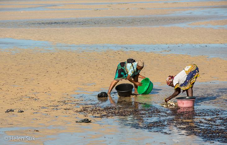 women washing clothes, vilanculos beach, mosambique