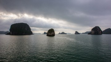 limestone karsts scattered across bai tu long bay vietnam