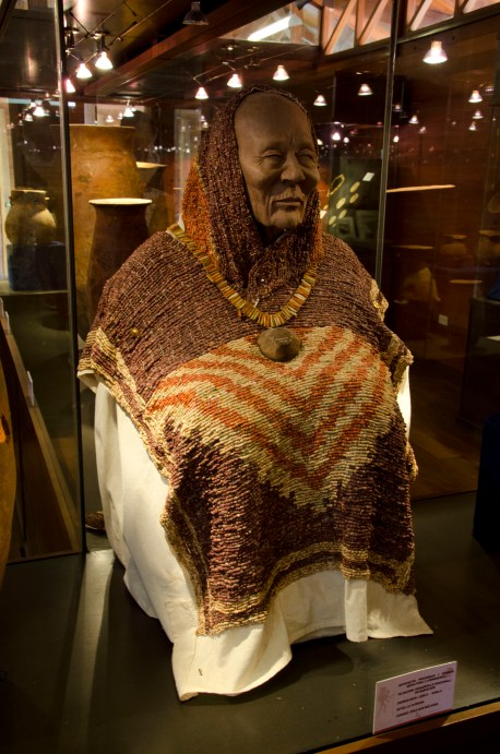 Front of the a beaded, shell poncho.