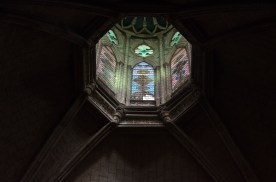 Stained glass windows adorn every nook and cranny, even up high.