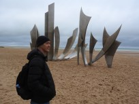 Omaha beach at low tide. The sculpture symbolizes the rise of freedom and the wings of hope.