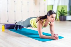 Woman in plank exercise pose