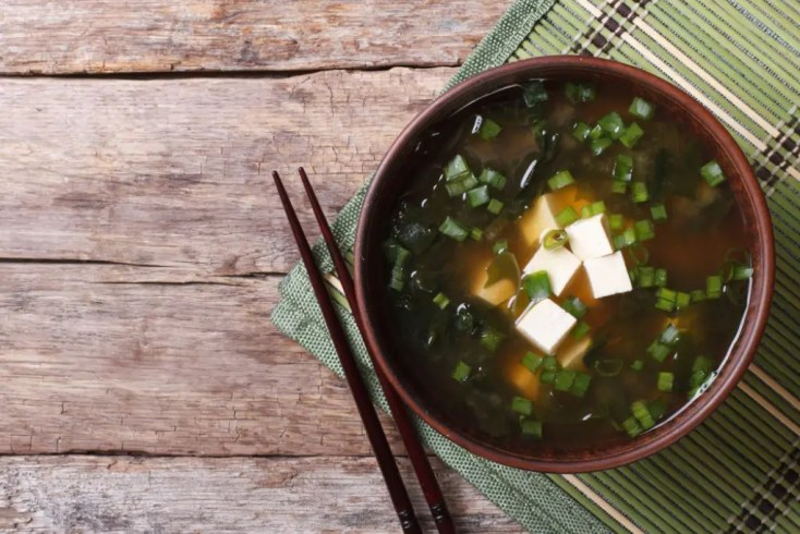 Bowl of miso soup with chopsticks by the side