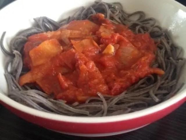 bowl of black bean pasta with a pasta sauce