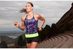 Girl running wearing a reflective belt