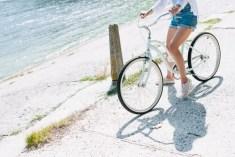 Woman on a bike near water