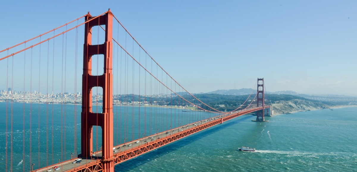 a photo of the golden gate bridge over blue water