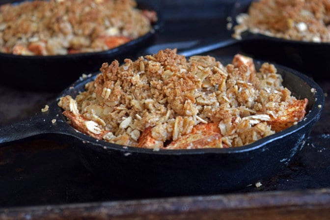 Delicious apple crisps made in individual cast iron skillets. Perfect recipe for a tasty and healthy dessert treat.