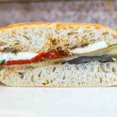 Recipe for a easy to assemble, make ahead Pressed Mediterranean Vegetable Sandwich. Perfect for entertaining and picnics.