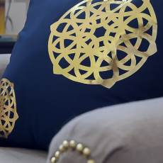 Cricut and it's Iron-On Gold Foil were all I needed to make these spiffy gold medallion pillows. These easy DIY pillows are the perfect addition to jazz up my home decor.