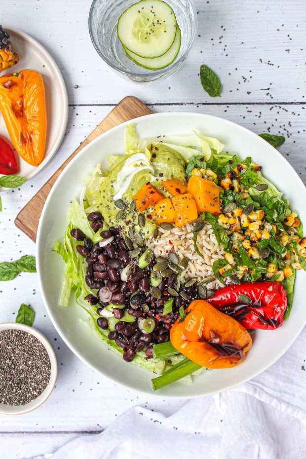 Charred Red Pepper Corn and Black Bean Bowl with Avocado Crème