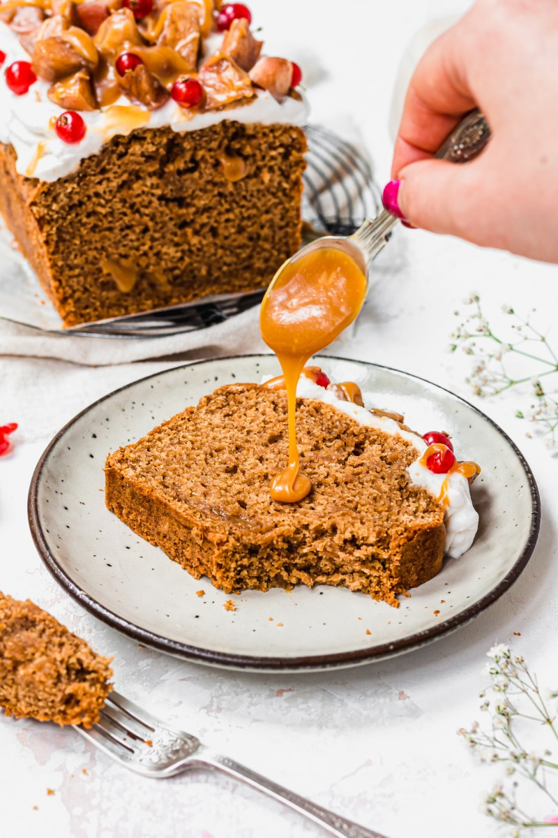 A slice of Caramel Apple Loaf Cake with caramel drizzling over