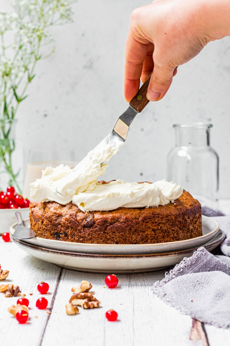 Frosting a Carrot and Raisin Bundt Cake