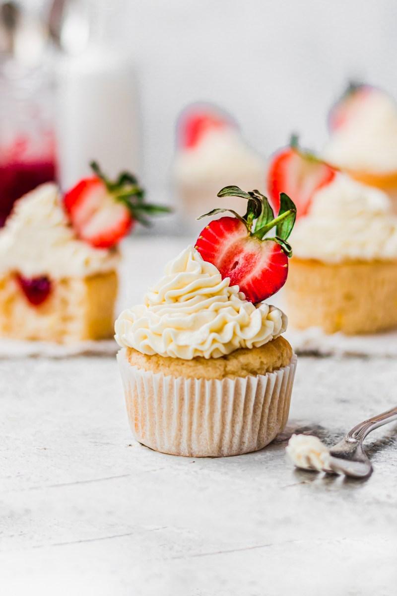 a Vegan Lemon Strawberry Cupcake with a fork