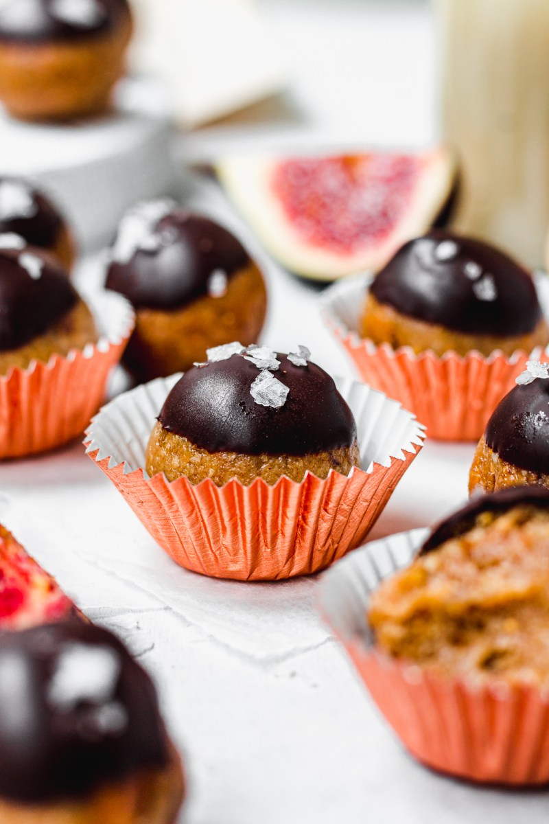Tahini Fig and Chocolate Bliss Balls in orange cases