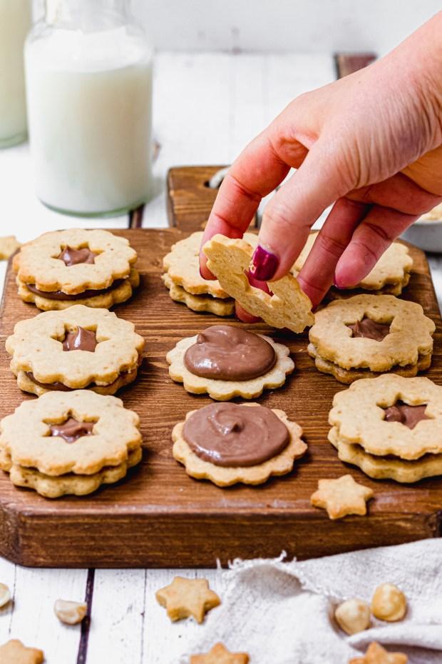 Sandwiching the Chocolate Hazelnut Linzer Cookies
