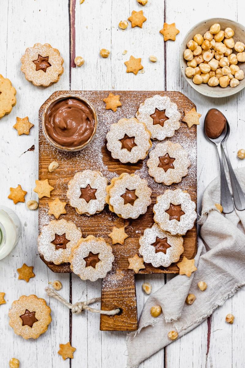 Chocolate Hazelnut Linzer Cookies on a wooden board